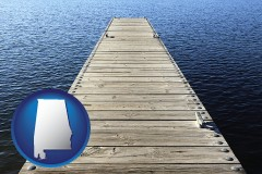 alabama map icon and a boat dock on a blue water lake