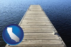 california map icon and a boat dock on a blue water lake