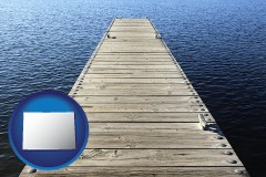 colorado map icon and a boat dock on a blue water lake