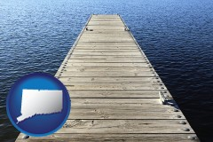 connecticut map icon and a boat dock on a blue water lake