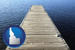 idaho map icon and a boat dock on a blue water lake