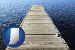 indiana map icon and a boat dock on a blue water lake