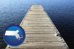 massachusetts map icon and a boat dock on a blue water lake