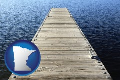 minnesota map icon and a boat dock on a blue water lake