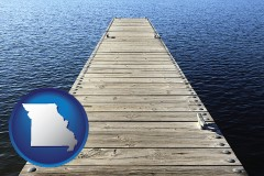 missouri map icon and a boat dock on a blue water lake