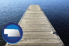 nebraska map icon and a boat dock on a blue water lake