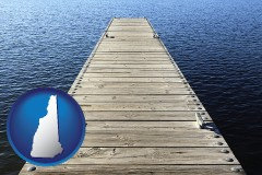 new-hampshire map icon and a boat dock on a blue water lake