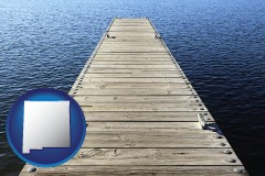 new-mexico map icon and a boat dock on a blue water lake
