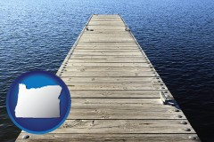oregon map icon and a boat dock on a blue water lake