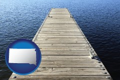 south-dakota a boat dock on a blue water lake