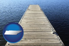tennessee map icon and a boat dock on a blue water lake