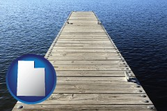 utah map icon and a boat dock on a blue water lake