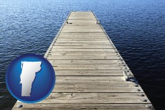 vermont map icon and a boat dock on a blue water lake