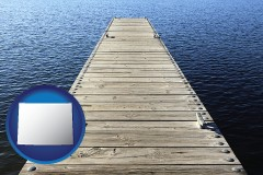 wyoming a boat dock on a blue water lake