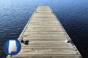 a boat dock on a blue water lake - with Alabama icon
