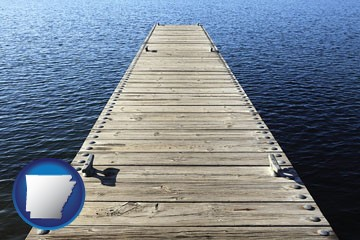 a boat dock on a blue water lake - with Arkansas icon