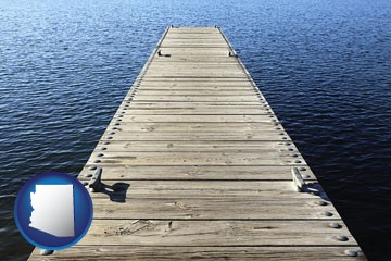 a boat dock on a blue water lake - with Arizona icon
