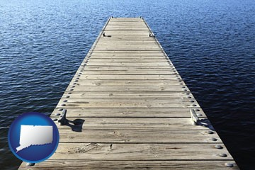 a boat dock on a blue water lake - with Connecticut icon