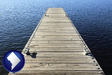 a boat dock on a blue water lake - with Washington, DC icon