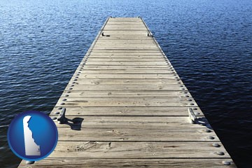 a boat dock on a blue water lake - with Delaware icon