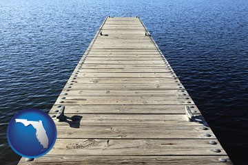a boat dock on a blue water lake - with Florida icon