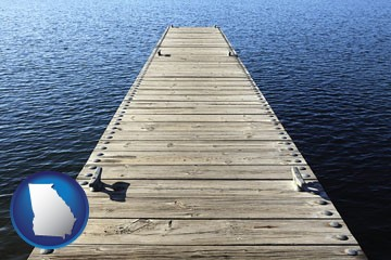 a boat dock on a blue water lake - with Georgia icon