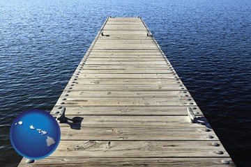 a boat dock on a blue water lake - with Hawaii icon