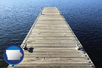 a boat dock on a blue water lake - with Iowa icon