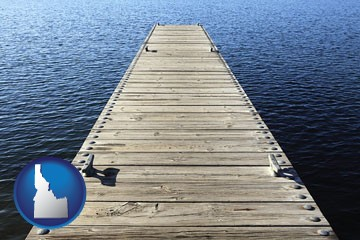 a boat dock on a blue water lake - with Idaho icon