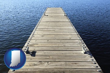 a boat dock on a blue water lake - with Indiana icon