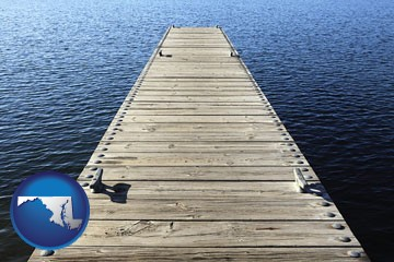 a boat dock on a blue water lake - with Maryland icon