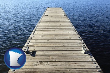 a boat dock on a blue water lake - with Minnesota icon