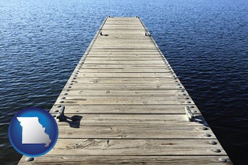 a boat dock on a blue water lake - with Missouri icon