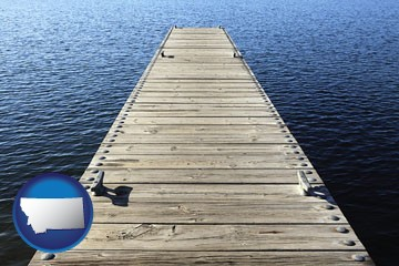 a boat dock on a blue water lake - with Montana icon