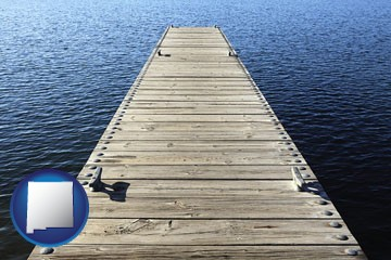 a boat dock on a blue water lake - with New Mexico icon