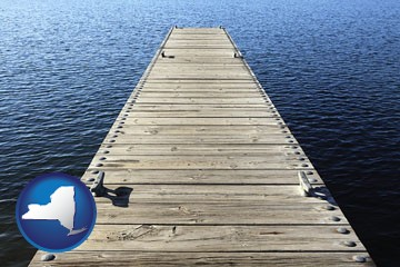 a boat dock on a blue water lake - with New York icon