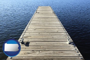 a boat dock on a blue water lake - with Pennsylvania icon