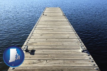 a boat dock on a blue water lake - with Rhode Island icon