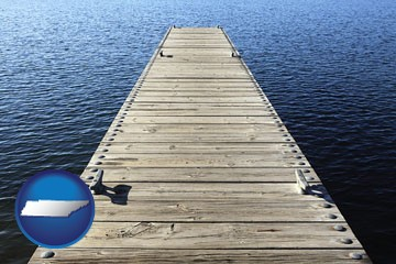 a boat dock on a blue water lake - with Tennessee icon