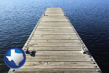 a boat dock on a blue water lake - with Texas icon