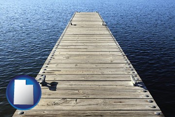 a boat dock on a blue water lake - with Utah icon