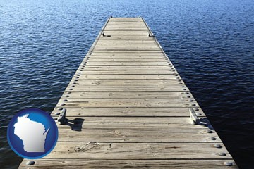 a boat dock on a blue water lake - with Wisconsin icon