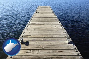a boat dock on a blue water lake - with West Virginia icon