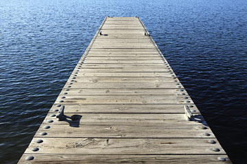 a boat dock on a blue water lake